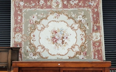 Large Aubusson Type Tapestry, with large floral spray & scroll frame, on a cream field and pink border