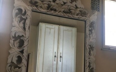 Large Henri II mirror in carved wood with white