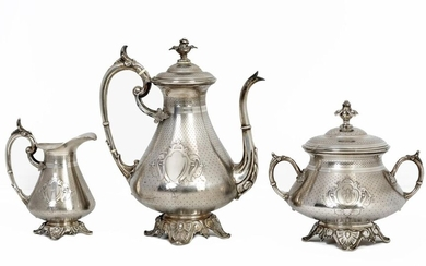 Napoleon III style quadripod coffee service in chased silver 833/1000 including coffee pot, sugar bowl and milk jug decorated with a coat of arms with numbers on a dotted background