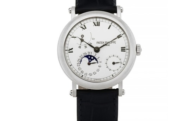 PATEK PHILIPPE | REF 5054 WHITE GOLD WRISTWATCH WITH DATE, POWER RESERVE AND MOON PHASE INDICATION CIRCA 2000