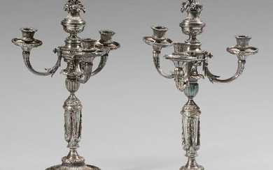 Pair of three-light silver plated metal torches richly...