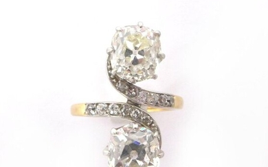 RING TOI ET MOI in 18K yellow and white gold holding two cushion cut diamonds of approximately 1.10 carat followed by a line of 8/8 diamonds. French work. Gross weight : 4,47 gr. A diamond and yellow gold ring.