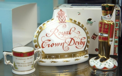THREE ROYAL CROWN DERBY PAPERWEIGHTS, INCLUDING 'TREASURES OF CHILDHOOD - SOLDIER', ROYAL BABY MINIATURE LOVING CUP AND COLLECTORS'.