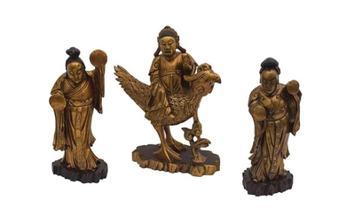THREE SOUTH-EAST ASIAN GILT AND LACQUERED CARVED WOOD...