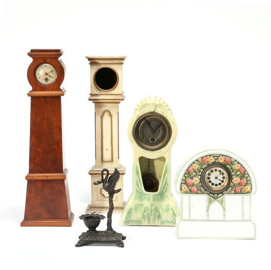 NOT SOLD. Two Jugend majolica clocks and three pocket watch holders. H. 16-40 cm. (5)...