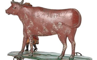 Woman and Cow Tin Toy