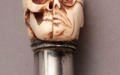 in lacquered wood and a carved ivory handle...