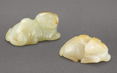 A CELADON AND RUSSET JADE FIGURE OF A LION AND A JADE 'GOAT AND LINGZHI' GROUP QING DYNASTY