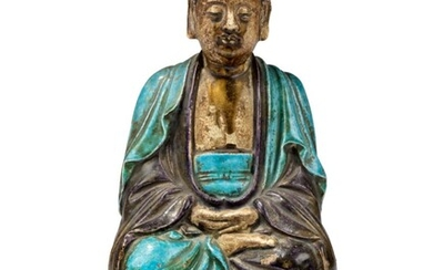 A CHINESE POTTERY FAHUA SEATED FIGURE OF SHAKYAMUNI, MING DYNASTY (1368-1644)
