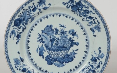 A Chinese 18th century blue and white charger. Painted in un...