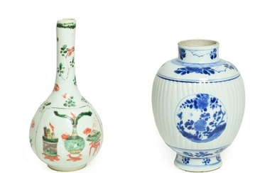 A Chinese Porcelain Vase, Kangxi, of fluted oval form with...