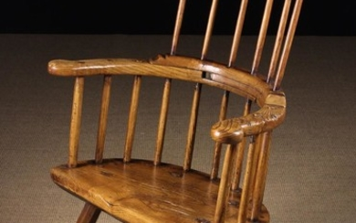 A Fine 18th Century Primitive Welsh Ash Comb-back Windsor Armchair. The slightly curved top rail abo