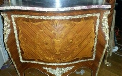 A French Marquetry Bronse Ormolu Commode. Late 19Th