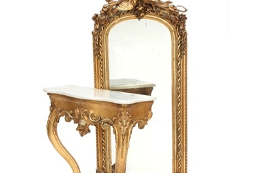 A Neo-Rococo giltwood mirror with accompanying cosole with marble top. Ca. 1860. H. 232 cm. W. 65 cm. D. 32 cm.