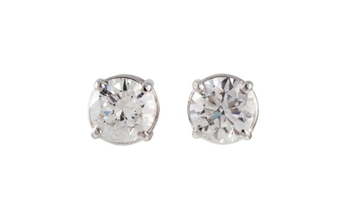 A PAIR OF DIAMOND SOLITAIRE STUD EARRINGS, with round brilli...