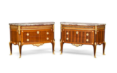 A PAIR OF LOUIS XVI STYLE MARBLE TOP GILT BRONZE MOUNTED INLAID MAHOGANY PLAQUÉ AND CONTREPLAQUÉ COMMODES