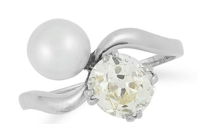 A PEARL AND DIAMOND TOI ET MOI RING set with a pearl