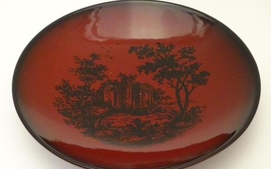 A Royal Doulton flambe dish depicting a wooded