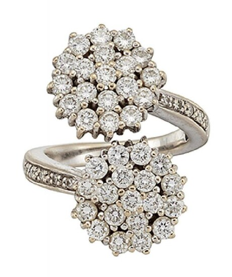 A diamond cluster ring, of crossover design,...