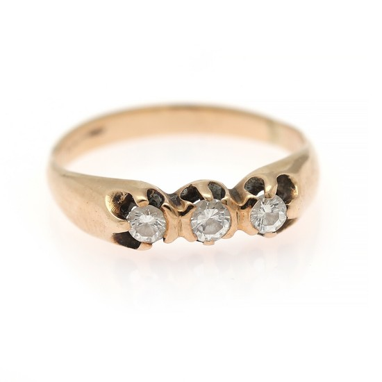 A diamond ring set with three brilliant-cut diamonds, mounted in 14k gold. Size 58.