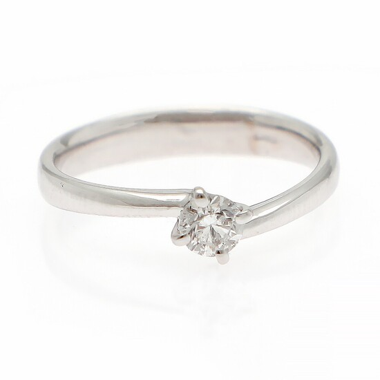 A diamond solitaire ring set with a brilliant-cut diamond weighing 0.30 ct., mounted in 18k white gold. River/SI2. Size 54.