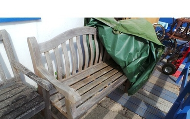 A hardwood garden bench with cover