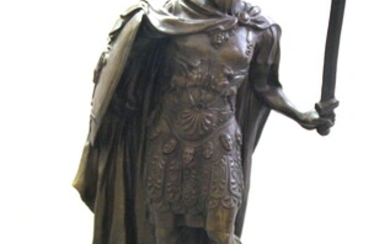 A large bronze figure of a Roman centurion on a green marble base, after C. R. Carrie, H. 76cm.