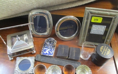 A mixed lot to include silver photo frames, two miniature bi...