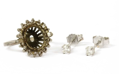 A pair of 18ct white gold single stone diamond stud earrings