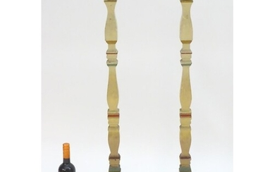 A pair of 20thC tall squared based candlesticks of carved wo...