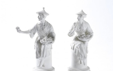A pair of Royal Worcester biscuit porcelain Chinese figures modelled by A. Azori