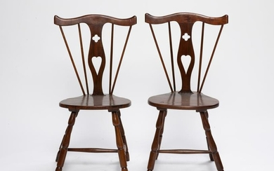 A pair of carved hardwood side chairs