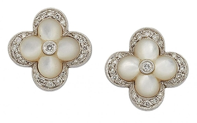 A pair of mother-of-pearl and diamond cluster...