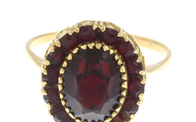 A red paste cluster ring.