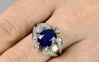 A sapphire and diamond dress ring.Sapphire calculated