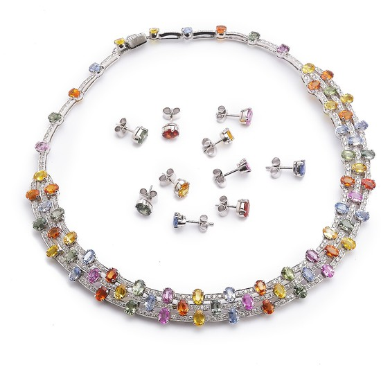 A sapphire and diamond jewellery set comprising a necklace and five pair of ear studs set with multi-coloured sapphires and diamonds, mounted in 18k white gold.