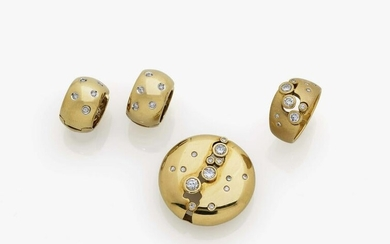 A set with brilliant cut diamonds: consisting of
