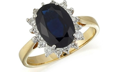 AN 18CT GOLD SAPPHIRE AND DIAMOND CLUSTER RING, an