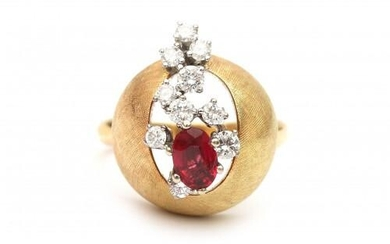 An 18 carat gold diamond and ruby bombé cocktail ring. Designed as a brushed yellow gold ball featuring ten brilliant cut diamonds of ca. 0.40 ct. in total, ca. G-H, ca VS and an oval cut ruby of ca. 0.50 ct. in the center. Gross weight: 14.3 g.