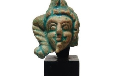 An Egyptian glazed composition head of Harpokrates