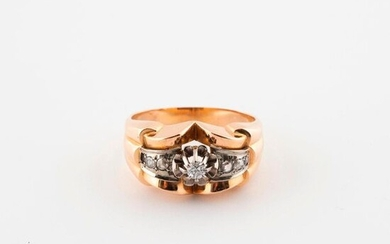Architectural ring in yellow and white gold (750) adorned with a half-cut brilliant diamond in claw setting in a setting of small rose-cut diamonds in grain setting.