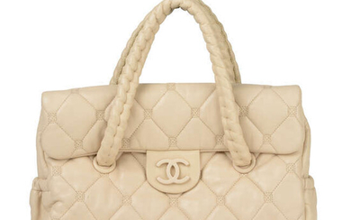 CHANEL - a pale quilted leather Hidden Chain handbag.