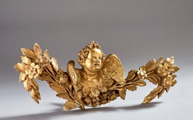 Carved and gilded wooden element depicting a winged angel and a leafy branch.