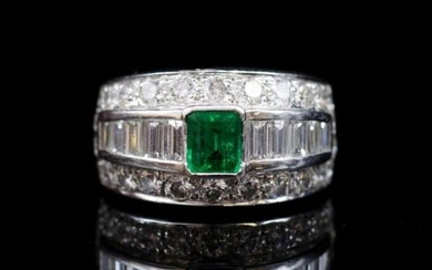 Emerald and diamond set 18ct white gold ring by Musson. Appr...
