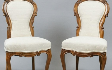 Pair of Victorian walnut rose carved side chairs