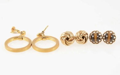 Three pairs of gold earrings.