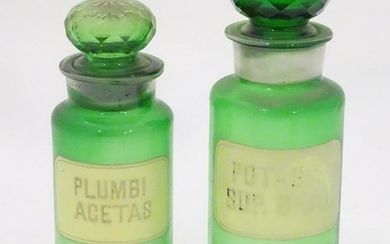 Two 20thC green glass pharmacy / chemist / apothecary