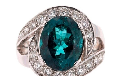 White gold tourbillon ring centered on a 5.15 carat oval-cut indigo tourmaline in a ring of diamonds totalling approximately 0.85 carat - Gross weight: 9.1 g