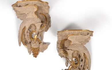 A pair of carved wood, painted and parcel gilt wall brackets, in George III style, 19th century and later