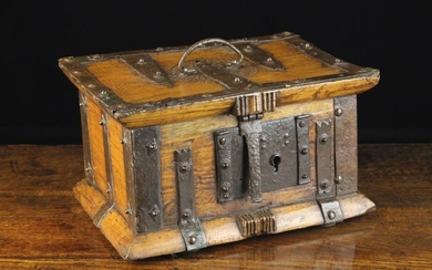 A 17th Century Spanish Wooden Iron Bound Box. The rectangular lid chip carved with a decorative roun